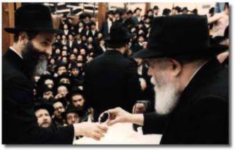 Herschel receiving wine from the Lubavitcher Rebbe